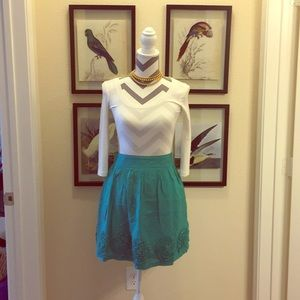 Francesca's: Criss Cross turquoise skirt